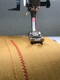 De steken op de naaimachine